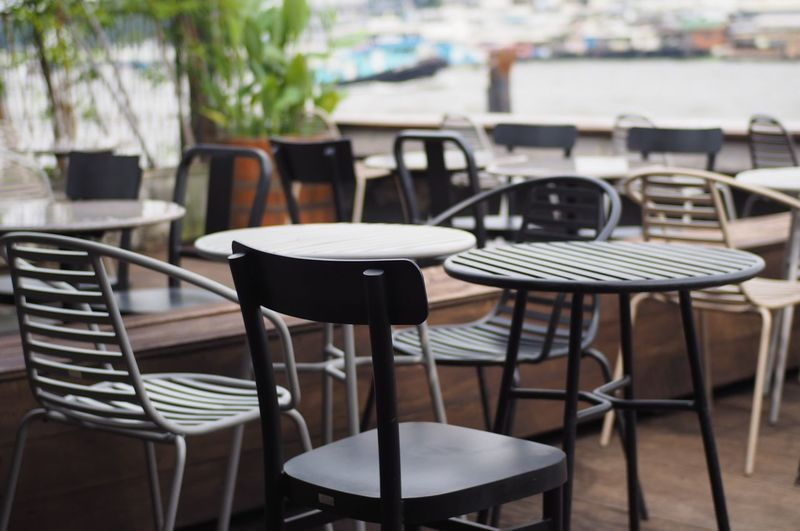 Empty chairs and table at cafe