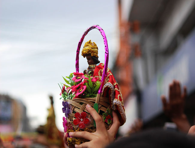A statue of Sto. Niño in a basket. The Week on EyeEm The Week Of Eyeem The Week on EyeEm Sinulog Festival Traditional Culture Traditional Festival Sinulog Philippines Street Tradition Celebration Traditional Festival Day One Person Easter Outdoors Human Body Part Adults Only Adult People
