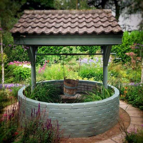 Wishing Well Bucket Garden Landscape No People Leisure Relaxation Garden Gardening Make A Wish Magic Garden