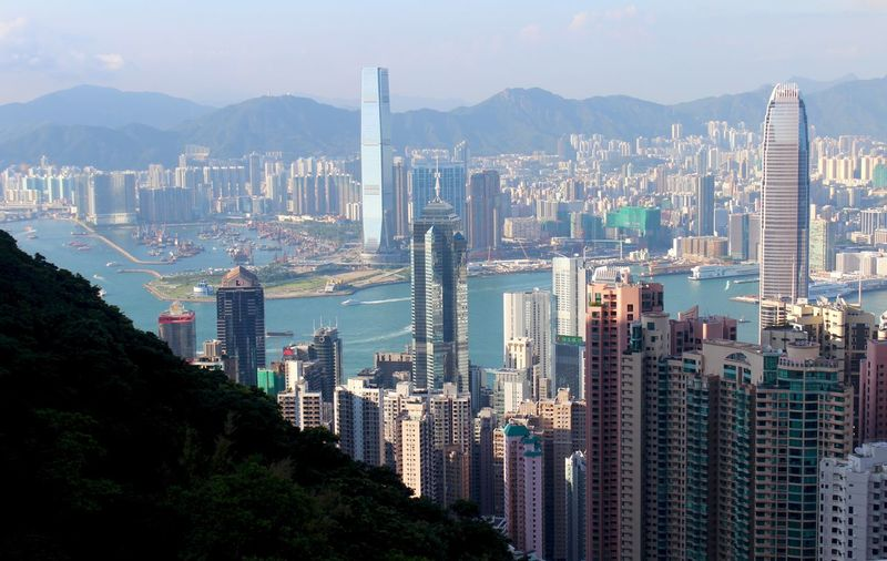 Architecture Blue Business Business Finance And Industry City Cityscape Cloud - Sky Downtown District Finance Finance And Economy Harbor Igniting Mountain Mountain Peak Night Outdoors Panoramic Pier Scenics Sea Sky Skyscraper Stock Market And Exchange Travel Urban Skyline