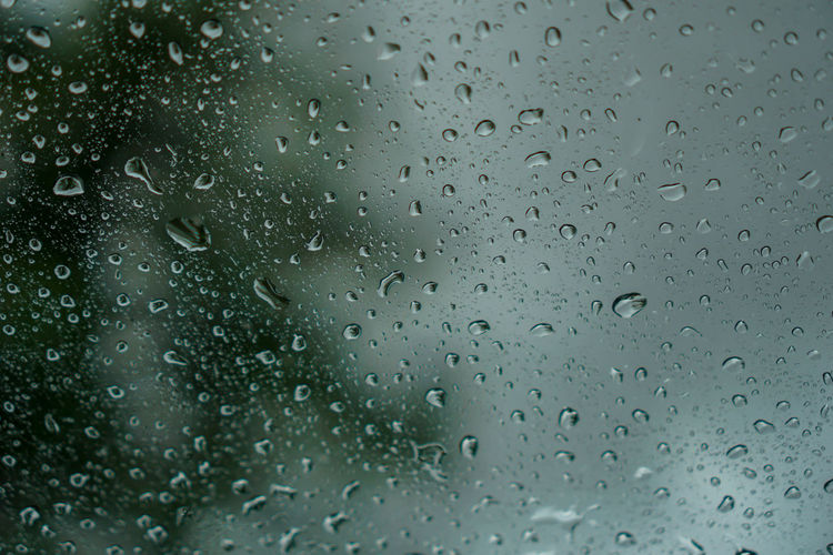 blur backgruond,Rain water on the car glass Drop Wet Window Rain Full Frame Water Backgrounds No People Glass - Material Close-up Nature RainDrop Transparent Indoors  Rainy Season Day Pattern