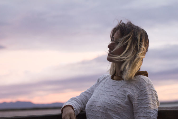 Rear view of woman looking at sunset