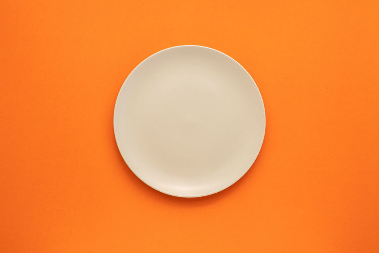 Directly above shot of electric lamp against orange background