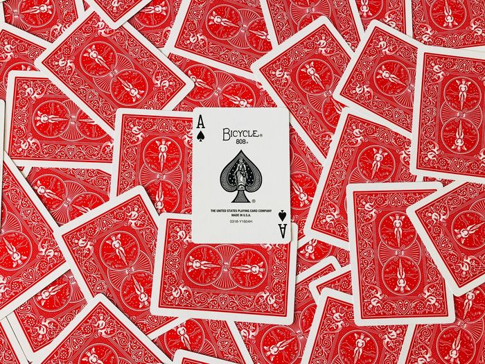 Bycicle Cards Ace Of Spades Playing Cards Red Pattern Full Frame Paper No People Textile Backgrounds Indoors  Letter Cards Design Art And Craft Close-up Large Group Of Objects Creativity Craft High Angle View