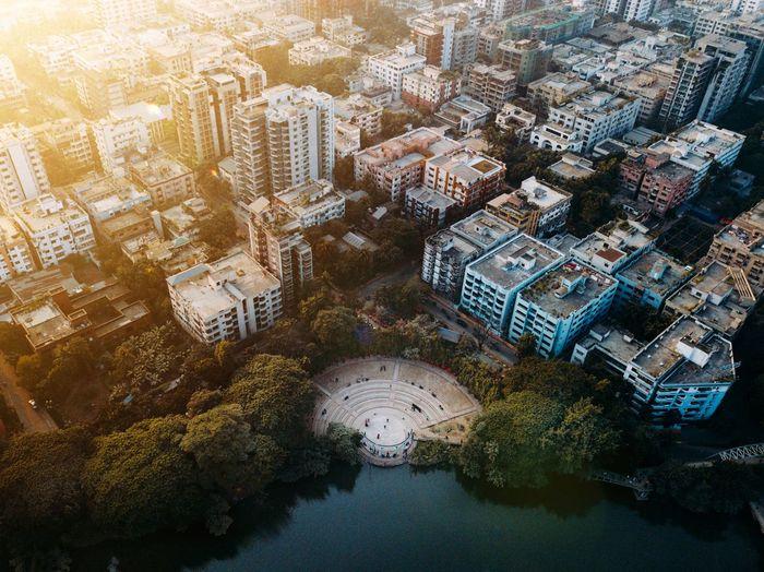 High angle view of dhanmondi lake amidst buildings in city of dhaka
