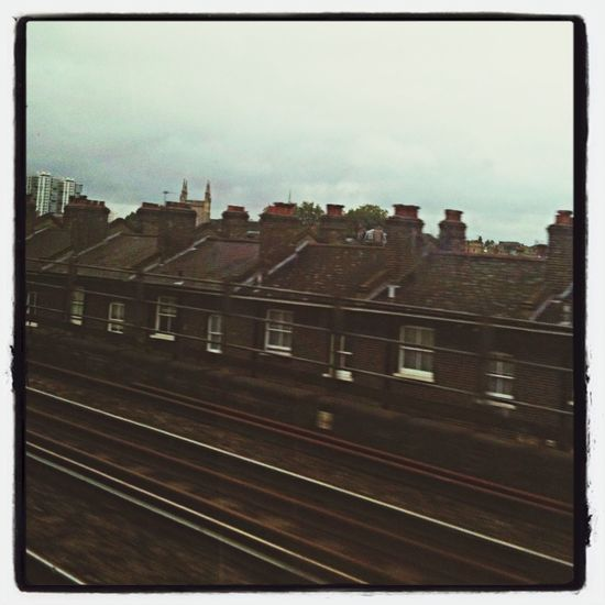 London suburbs from my train window Train Gatwick Express Traveling uUrban