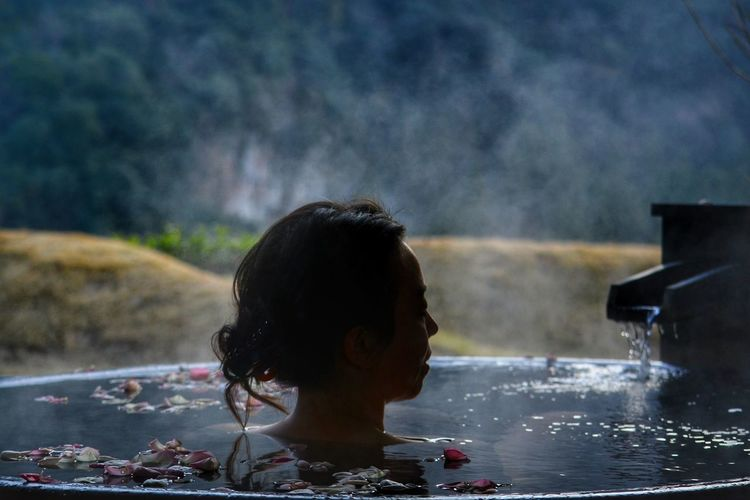 Portrait of woman in a hot tub