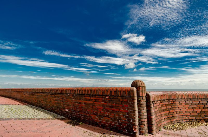 Retaining Wall Against Blue Sky During Sunny Day