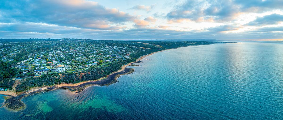 Aerial panorama of beautiful ocean coastline at dusk in australia