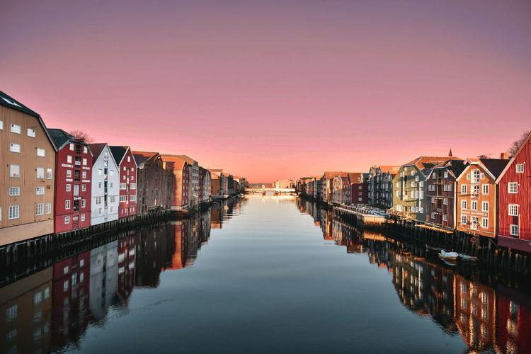 """Trondheim Dreaming"" Architecture Sky Water Sunset Built Structure Building Exterior Nature Reflection No People Transportation Building City Canal Waterfront Diminishing Perspective Travel Destinations Copy Space Pier In A Row Outdoors"