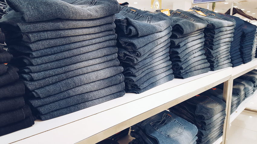 Abundance Arrangement Choice Close-up Collection Day Denim Display In A Row Jeans Jeans Shopping Large Group Of Objects Market Market Stall Pants Rack Repetition Retail  Retail  Shelf Shopping Side By Side Stack Textile Variation