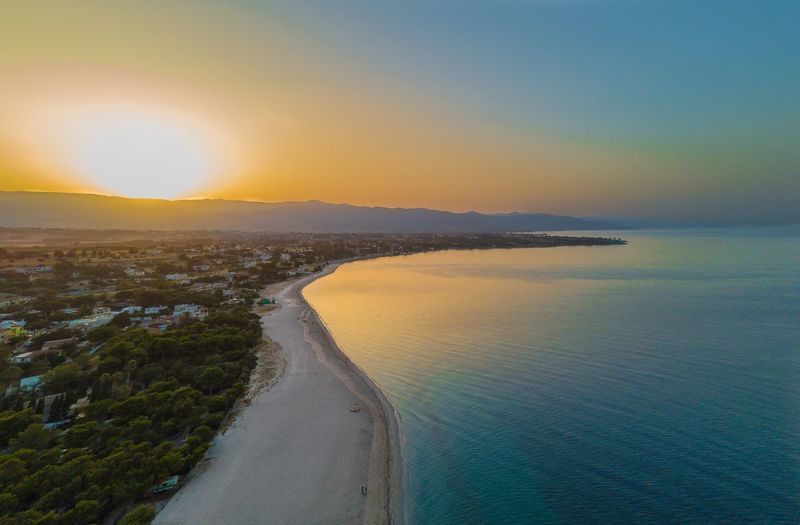 Dronephotography Aerial View Drone  Sky Water Beauty In Nature Sea Scenics - Nature Sunset Tranquility Land Nature Beach Horizon Idyllic Outdoors Sun Orange Color No People Non-urban Scene Tranquil Scene Horizon Over Water