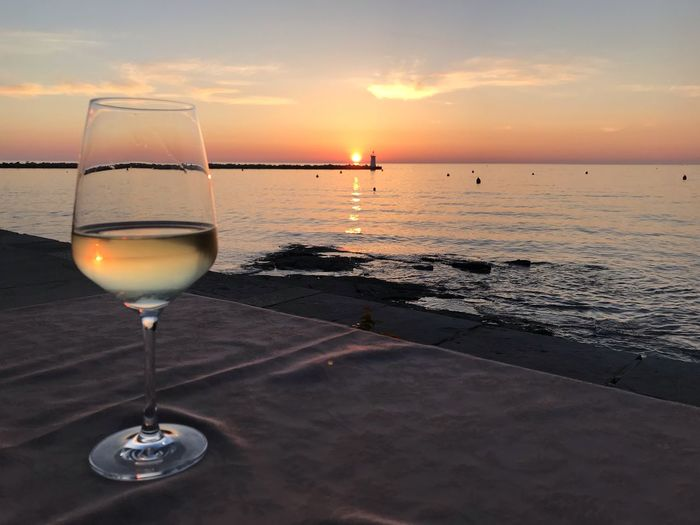 Sundown Croatia ❤ Sunset Sky Drink Sea Refreshment Glass Alcohol Horizon Over Water Beauty In Nature Food And Drink Scenics - Nature Horizon Wineglass Water Idyllic No People Wine Beach Land