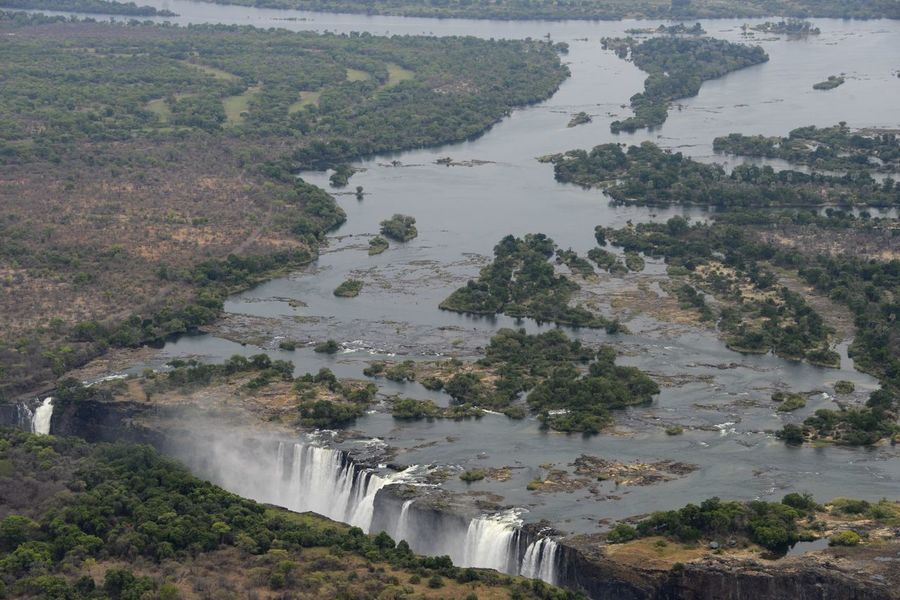 Arial Shot National Park Victoria Falls Africa Zimbabwe Zambesi River Zambia Zimbabwe Arial Arial Photography Arial View Arialview Border High Angle View Power In Nature River Victoria Falls Victoria Falls In Zambia, Africa View From Helicopter Water Waterfall Zambesi
