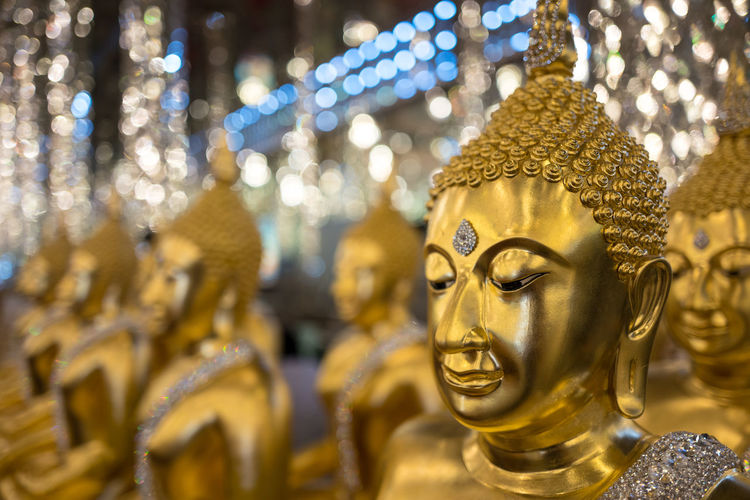 Gold Buddha statue headshot in the thai temple Buddha Head Buddha Image Buddha Statue Buddha Temple Close-up Focus On Foreground Gold Gold Colored Golden Color Idol Illuminated No People Place Of Worship Religion Sculpture Spirituality Statue