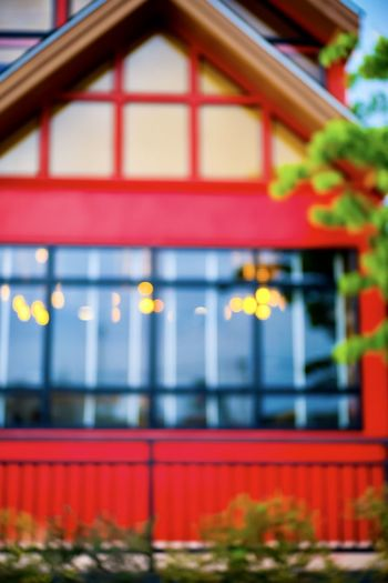 Architecture Building Exterior Built Structure Red No People Building Focus On Foreground House Outdoors Day Selective Focus Window Close-up Communication Residential District Illuminated Barrier Nature Fence Plant