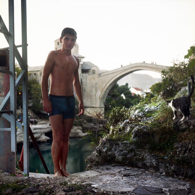 Balkan Mostar Mostar Bosnia Mostar Bridge Mostar ♥ Old Town Balkans Bridge - Man Made Structure Cat Full Length Jumper Lifestyles Mostar Jumper Neretva Neretva River One Person Outdoors Portrait Real People Shirtless Standing Water Young Adult Young Men EyeEmNewHere This Is Masculinity Go Higher