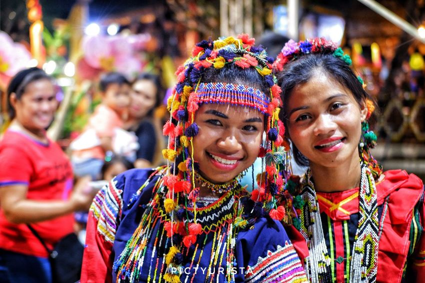 """Tribo, mga babae"" A group portrait of 2 lumad girls dressed in their colorful cultural clothes, this pi was taken during the opening ceremony of Kadayawan sa Davao 2018. Fujifilm XT100 7artisans Randomphotos Composition Hobbyistphotographer Ndfiltered Philippines Fuji Landscapephotography Photographer Newbie Streetphotographyworldwide Lensculture Street_focus_on Streets_storytelling Streetphotography Streetsleaks Streetphotographycommunit Streetclassics Portrait Smiling Multi Colored City Happiness Cheerful Togetherness Looking At Camera Headshot Celebration"