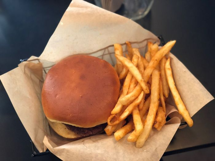 Cannot say no to burger. Happy hour for fries!! Junk EyeEm Selects Food French Fries Prepared Potato Food And Drink Freshness Unhealthy Eating Ready-to-eat No People Fast Food Deep Fried  Table Paper Close-up Indoors  Day Take Out Food