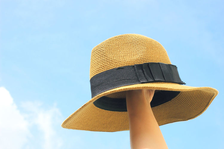 Sky Low Angle View Day Nature No People Hat Protection Outdoors Sunlight Security Blue Close-up Safety Yellow Cloud - Sky Summer Hand Holding Fashion Summertime