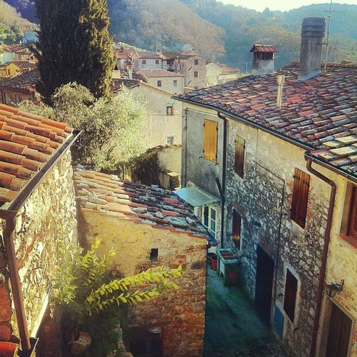 Waking up with the view of a little Tuscany village perched in the mountains
