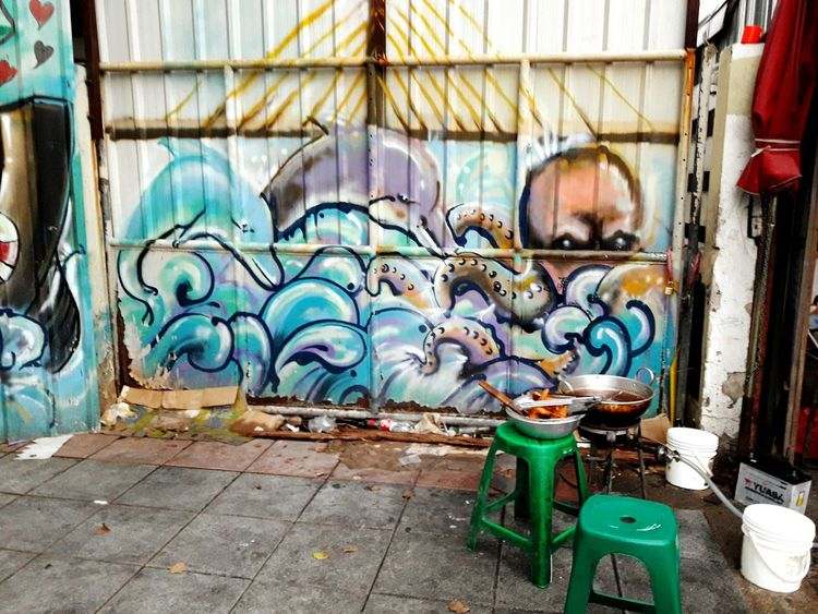 Take to the streets EyeEm Selects Day No People Outdoors Building Exterior Architecture Graffiti Wall Streetart/graffiti Phone Photography Colorful Variation Color Palette Variant Daytime EyeEm Best Shots Cooking Outdoors Streetphoto_color Street Photography Bangkok Thailand.