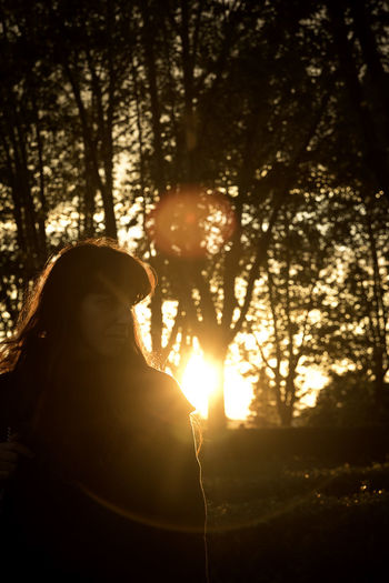 Autumn Orange Backlit Beauty In Nature Flare Melancholy Nature One Person Outdoors Portrait Silhouette Sunlight Sunset Tranquility Tree Women