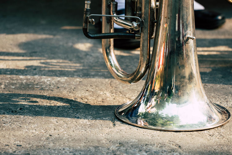 Close-up of trumpet on road