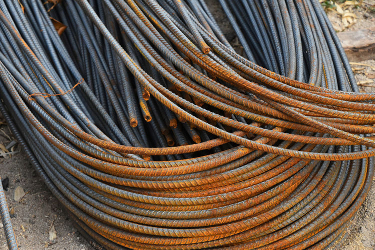 Stock of rmature metal fitting rods with rusty corroded tips Armature Bars Close-up Construction Construction Site Corroded Corrosion Decay Detail Ecology Environment Fitting Heap Heavy Industrial Industry Material Metal Orange Color Pivotal Ideas Rods Rusty Stock Warehouse