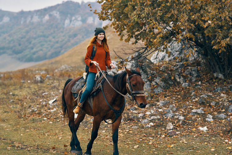 Young woman riding horse
