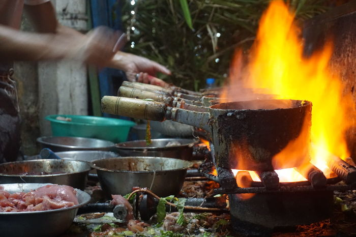 Burning Close-up Cooking Day Flame Food Food And Drink Freshness Heat - Temperature Human Body Part Human Hand Men One Person Outdoors People Preparation  Real People Street Food Streetfood Worldwide Streetphotography The Street Photographer - 2017 EyeEm Awards Food Stories