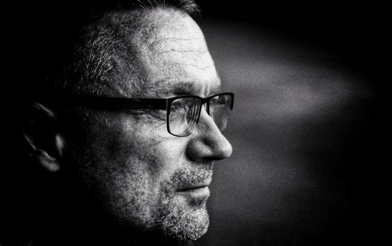 Close-up of thoughtful man wearing eyeglasses looking away