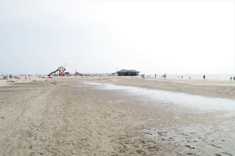 beach St. Peter Ording Strandkorb Beach Beauty In Nature Clear Sky Copy Space Day Environment Incidental People Land Nature Non-urban Scene Outdoors Sand Scenics - Nature Sea Sky Surface Level Tranquil Scene Tranquility Transportation Water
