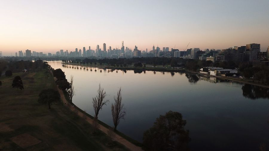 Dusk on the Lake Drone  Aerial View View Lake Golden Hour Australia Melbourne EyeEm Selects Sky Building Exterior Architecture Water City Built Structure Reflection Nature Landscape Sunset Cityscape Urban Skyline Travel Destinations Skyscraper Dusk Outdoors Building River Tree