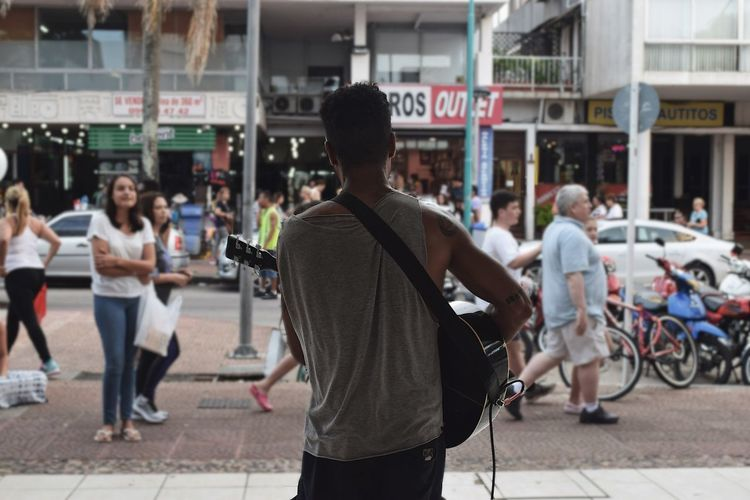 Man Playing Guitar In Market