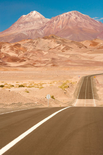 Road against mountains at desert