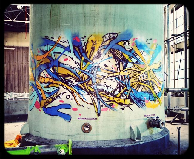 Rashe Graffiti in Abandoned Places disused factory chemical storage Tank
