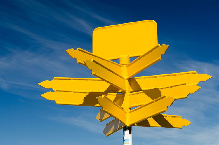 Blank yellow road sign on a blue sky background Arrow Backgrounds Blue Choice Day Decision Direction Empty Guidance No People Opportunity Road Sign Sign Sky Transportation Turn Yellow