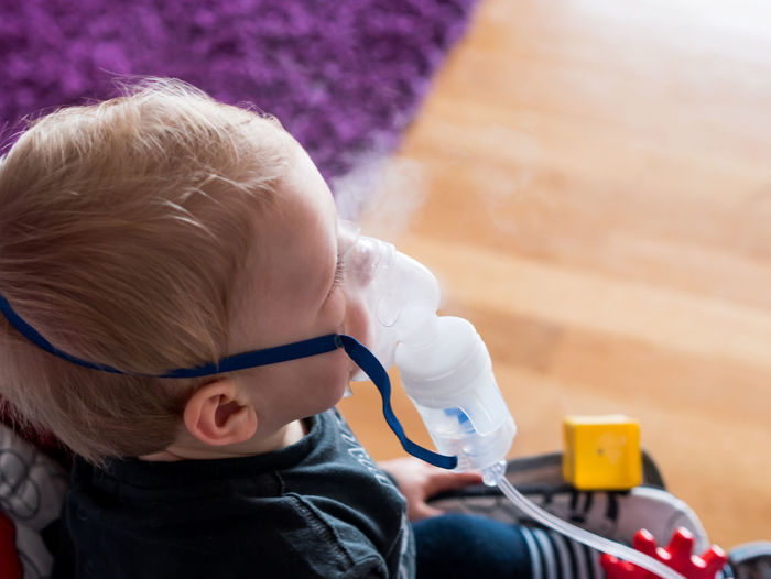 High angle view of cute baby boy taking steam at home