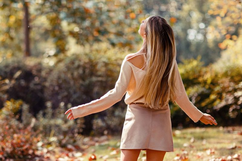 Young woman with blonde hair from behind dancing in the park Fall Colors Girl Power Girl Stylish Long Hair Blonde Hair Blonde Blonde Girl Hair Style Hairstyle Woman Behind Dancing Dancing Dance Hair One Person Hairstyle Long Hair Women Adult Rear View Standing Leisure Activity Lifestyles Real People Young Adult Day Autumn Beauty In Nature