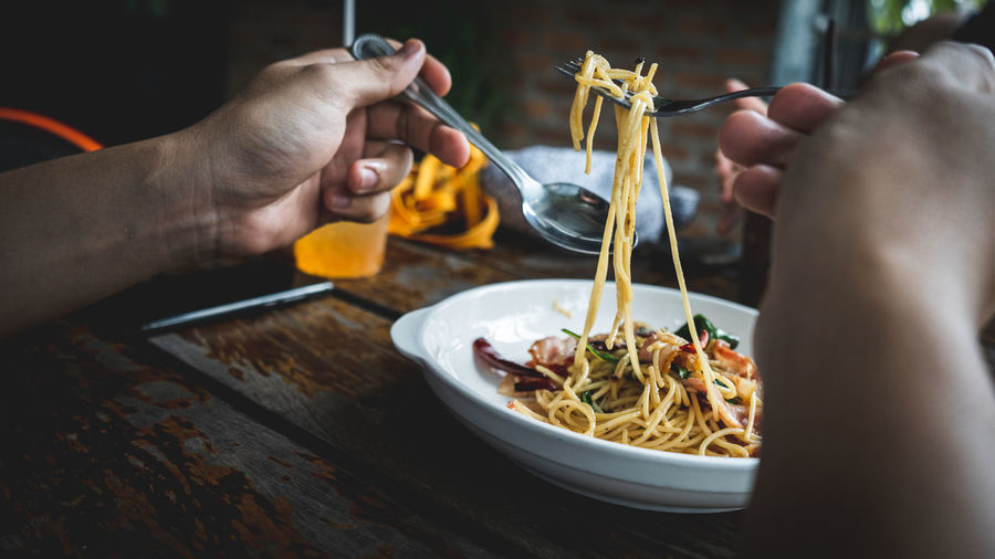 I Love Spaghetti Eating Utensil Finger Food Food And Drink Freshness Glass Hand Holding Human Body Part Human Hand Italian Food Leisure Activity Lifestyles Men Pasta Real People Spaghetti Table Unrecognizable Person Women