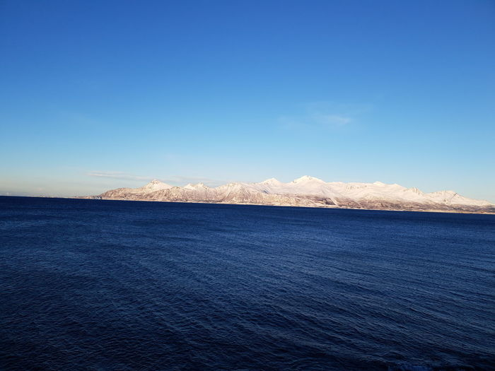 Bodø Bestsellers Ocean Beautiful View Norway Clear Sky Sea Blue Water Cityscape Salt - Mineral Hill Sky Architecture Landscape Rocky Mountains Calm Water Surface Mountain Range View Into Land Snowcapped Tranquil Scene Snowcapped Mountain Arid Landscape Coast Rugged Mountain