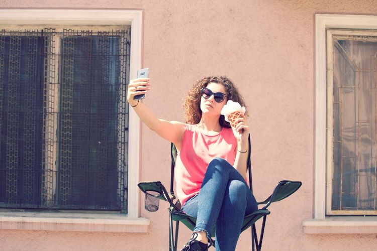 Pretty girl taking selfie outside on the balcony Posing Ice Cream Relaxing Self Portrait Selfie ✌ Beautiful Enjoying The Sun Fashion Happy Colorful Girl Lifestyles Outdoors Outside Photography Smile Summer Sun Woman Portrait