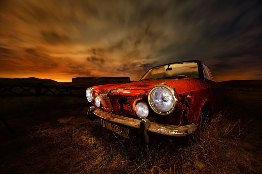 Red Car Abandoned Coche Chatarra Nightphotography Night Clouds Cloud - Sky Sunset Headlight Transportation Mode Of Transport Retro Styled Sky No People Land Vehicle Old-fashioned