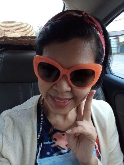 Portrait of woman wearing sunglasses in car