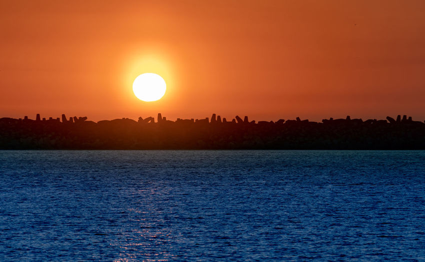 Sky Sunset Water Beauty In Nature Scenics - Nature Waterfront Sun Tranquility Tranquil Scene Silhouette Orange Color Sea Nature Idyllic No People Rippled Sunlight Non-urban Scene Outdoors Romantic Sky