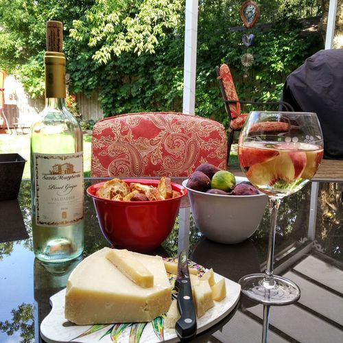 Summer repast on the back deck Summerliving Wineglass Wine Wineandcheese Summer Southern Ontario Bottle Close-up Day Drink Drinking Glass Food Food And Drink Freshness Fruit Healthy Eating No People Outdoors Ready-to-eat Refreshment Table