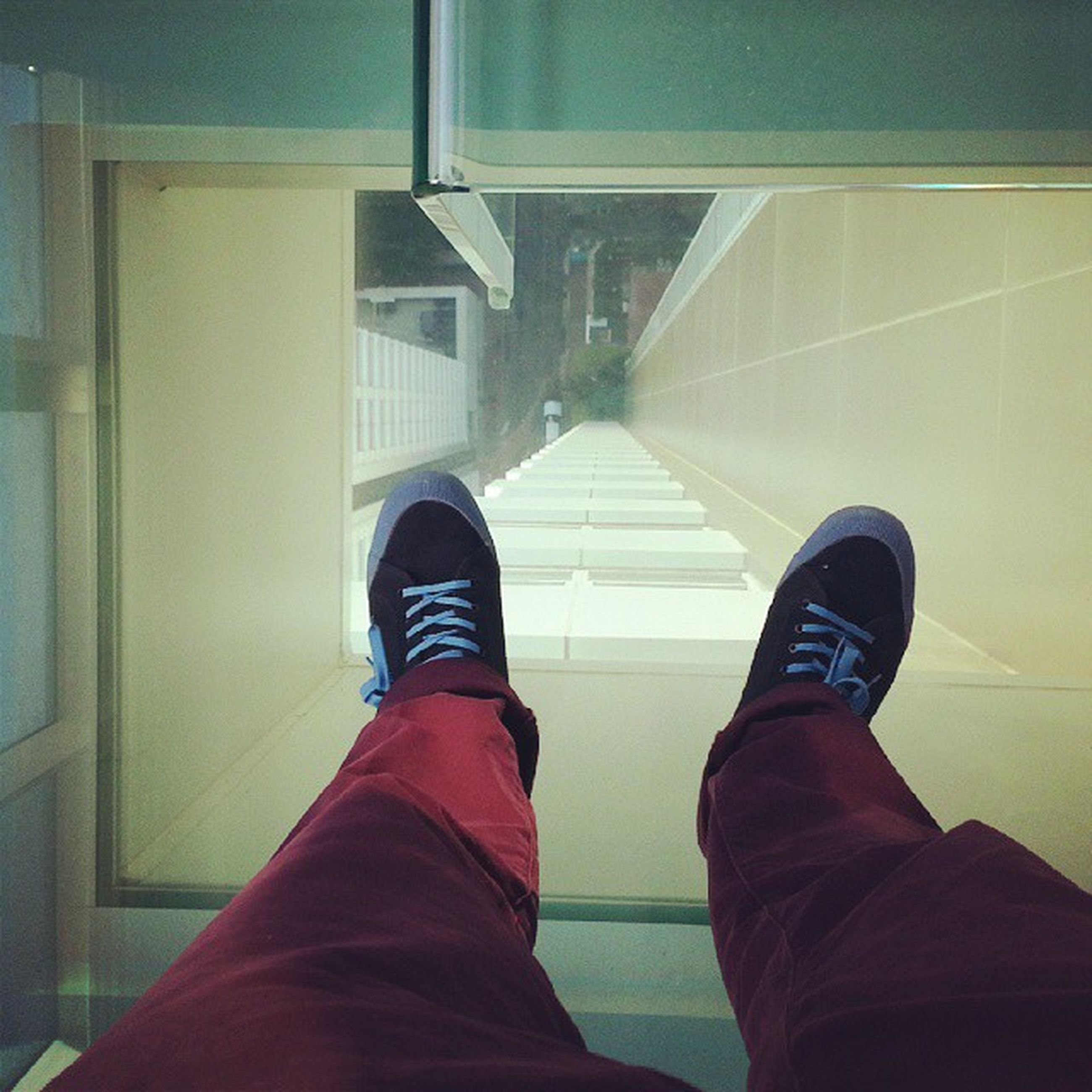 low section, person, indoors, shoe, standing, personal perspective, lifestyles, men, jeans, casual clothing, human foot, architecture, flooring, built structure, tiled floor, tile, footwear