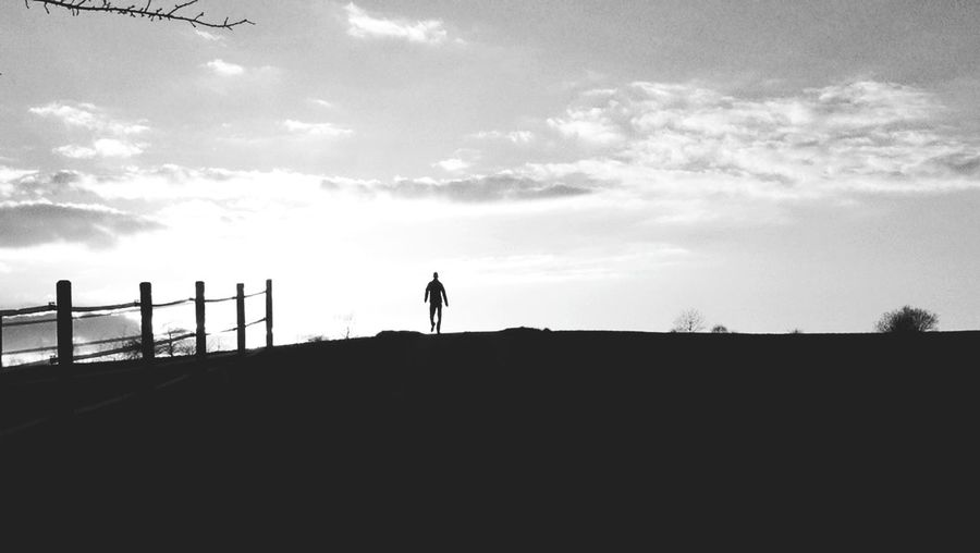 Someone Silhouette Sunset Sunset Silhouettes Evening Calm Blackandwhite Sky And Clouds Silhouettes Of People Evening Light Nature Nature On Your Doorstep EyeEm Best Shots Eye4photography  EyeEmBestPics Full Length Silhouette Sky Cloud - Sky Tranquil Scene Sun Tranquility