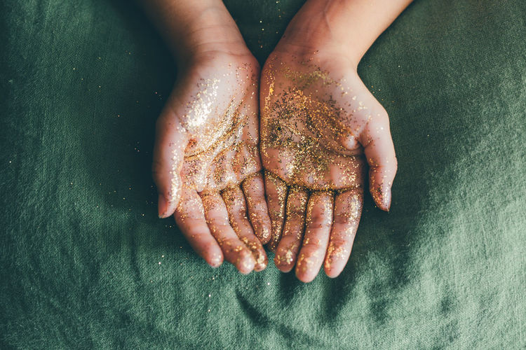 Bright Christmas Glitter Green Hands Sparkling Child Girl Glittering Glowing Golden Color Human Body Part Human Hand Kid Magic One Person Unrecognizable Person